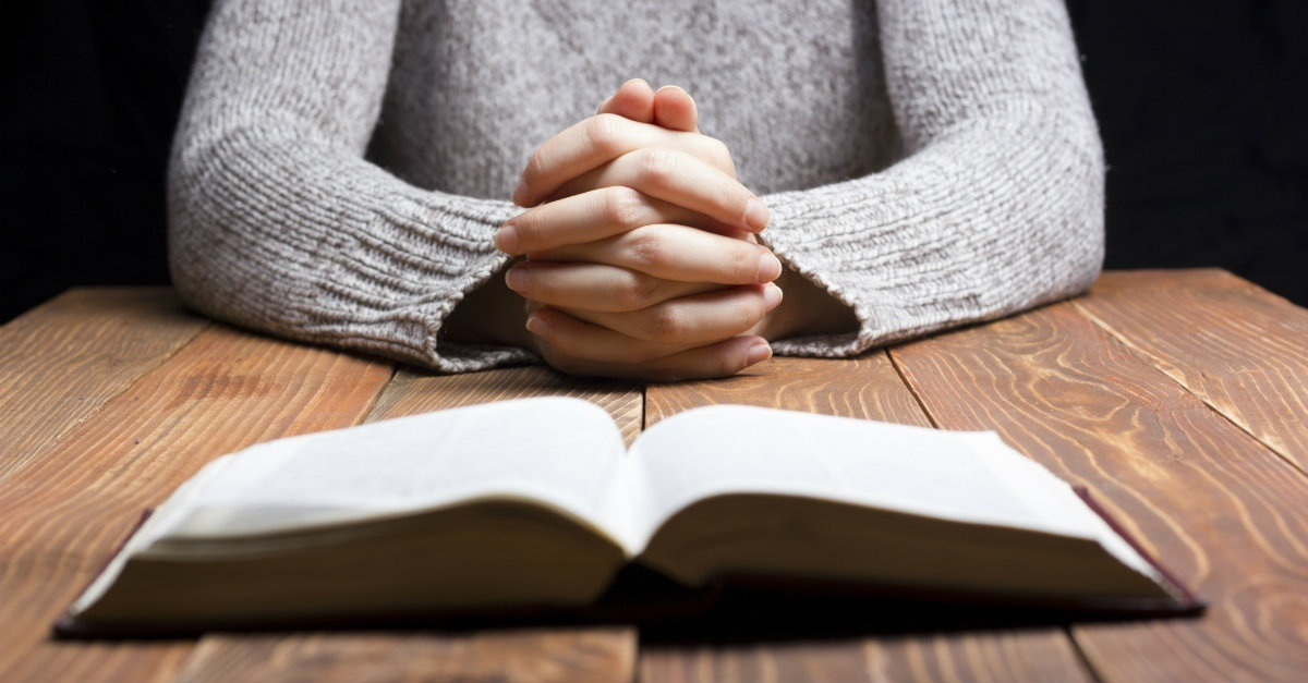 30237-praying-woman-bible-1200.1200w.tn